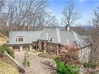 EXQUISITE CUSTOM BUILT HOME WITH SPECTACULAR MOUNTAIN VIEWS