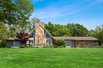 IMMACULATELY MAINTAINED HOME WITH 320 FEET OF LAKE MICHIGAN WATERFRONT VIEWS