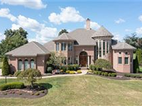 EXQUISITE BRICK HOME WITH CUSTOM DETAILS THROUGHOUT