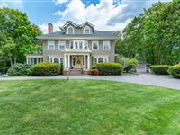 CLASSIC COLONIAL ON GORGEOUS ACRE LOT IS A TIMELESS BEAUTY