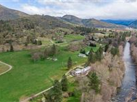 AN OREGON DREAM - 14 ACRES WITH APPLEGATE RIVER FRONTAGE