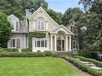 STUNNING HOME WITH BEAUTIFULLY LANDSCAPED YARD FEATURING GARDENS AND FOUNTAIN