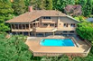 BREATHTAKING PANORAMIC VIEWS FROM HILLSIDE HOME IN BELLEVUE