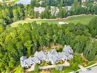GRAND CUSTOM HOME IN SOUGHT-AFTER RIVER CLUB