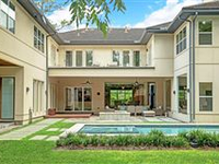 STUNNING CONTEMPORARY STONE AND STUCCO HOME WITH PRISTINE POOL AND SPA