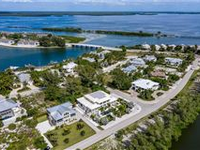 LOVELY NORTH SHORE HOME WITH GORGEOUS VIEWS OF LAKE GASPARILLA