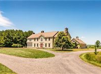 STUNNING CUSTOM-BUILT COLONIAL ON 45 ACRES OF TRANQUIL PRIVACY