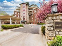 ELEGANT CRESTWOOD CONDO WITH EXPANSIVE PRIVATE BALCONY