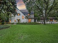 CHARMING TUDOR JEWEL WITH PICTURESQUE BACKYARD AND POOL