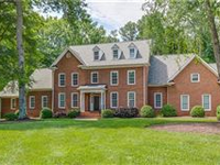REMARKABLE HOME IN DESIRABLE RIVER ROAD CORRIDOR
