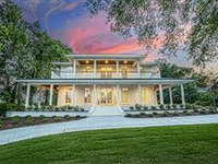 THIS EXCEPTIONAL COASTAL SOUTHERN INSPIRED RESIDENCE IN LANDFALL IS SITUATED ON A PREMIER LOT