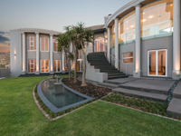 SECLUDED SOPHISTICATION AT THE HEART OF FEATHERBROOKE ESTATE