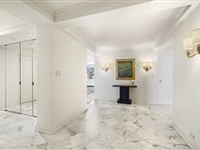SUN-FLOODED SOUTH-FACING PENTHOUSE WITH OUTDOOR SPACE ON FIFTH AVENUE
