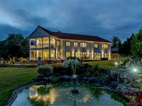 SUBSTANTIAL HOME IN PEACEFUL SETTING