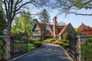 MAGNIFICENT ARCHITECT-DEISGNED TUDOR HOME WITH MODERN AMENITIES