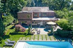 MAGNIFICENT SOUTH FACING STONE AND BRICK COLONIAL