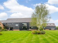 OLD BARN HOUSE IS AN IMPRESSIVE PROPERTY SET IN APPROXIMATELY ONE ACRE