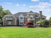 STUNNING AND GRANDIOSE CENTER HALL COLONIAL