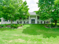 STATELY BUNGALOW ON ALMOST SEVEN ACRES