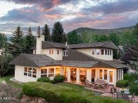 BRIGHT AND SUNNY SINGLE FAMILY HOME WITH PANORAMIC MOUNTAIN VISTAS