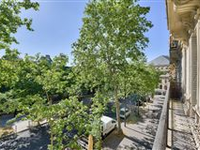 BRIGHT SECOND FLOOR APARTMENT WITH CONTINUOUS BALCONY