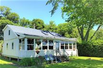 ADIRONDACK STYLE LAKEFRONT COTTAGE IN TRANQUIL SETTING WITH MAGNIFICENT VIEWS