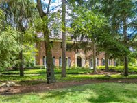 LUXURY MEET TRANQUILITY IN THIS PRIVATE WOODED ACRES PROPERTY