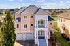 CUSTOM BUILT MODEL HOME IN THE PENINSULA WITH POND AND GOLF COURSE VIEWS