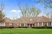 METICULOUSLY MAINTAINED BRICK HOME WITH GOLF VIEWS