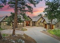 EXPANSIVE CUSTOM STUCCO AND STONE HOME IN GENESEE PARK