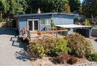 UPDATED MID-CENTURY MODERN HOME IN COVETED NEIGHBORHOOD