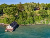 EXPERIENCE THIS LOVINGLY RESTORED LAKEFRONT HOME TO APPRECIATE ITS MAGIC