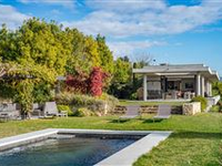 THIS PEACEFUL ARCHITECT-DESIGNED PROPERTY IS SET UPON BEAUTIFULLY LANDSCAPED GROUNDS