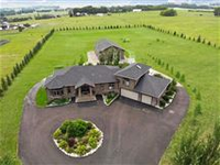 STUNNING AND STYLISH BUNGALOW ON FIVE ACRES OUTSIDE CALGARY