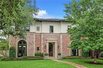 HANDSOME TWO-STORY BRICK HOME