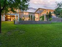 STUNNING MODERN FRANK LLOYD WRIGHT INSPIRED HOME IN WYNDHAM HILL WITH