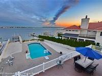 STUNNING CUSTOM BAY-FRONT HOME WITH PANORAMIC VIEWS