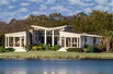 CONTEMPORARY LAKEFRONT MASTERPIECE IN THE HEART OF LANDFALL