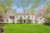 CLASSIC COLONIAL IS SET ON 4.87 LUSH PRIVATE ACRES