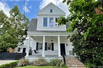 LOVELY UPTOWN HOME WITH CLASSIC ARCHITECTURAL DETAILING THROUGHOUT