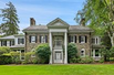 MAGNIFICENT GATED STONE COLONIAL ON FOUR ACRES