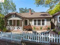 CHARMING HOME TUCKED AWAY ON A QUIET CUL-DE-SAC SURROUNDED BY MAJESTIC OAK TREES