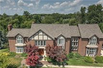 THIS MAJESTIC TUDOR SITS ON A LUSH PRIVATE LOT WITH PRIVACY AND NATURE