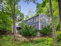 STUNNING CUSTOM-BUILT CONTEMPORARY BACKING TO HILLWOOD COMMUNITY PRESERVE