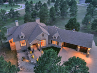 TUCKED AMONG THE TREES ON OVER FIVE ACRES