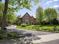 BUILT IN 1929, STATELY BRICK MANOR WITH COACH HOUSE