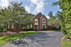 CUSTOM HOME ON PRIVATE WOODED LOT
