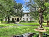 DAVIS HOME SITUATED ON OVER AN ACRE OF BEAUTIFULLY LANDSCAPED GROUNDS