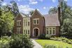 CUSTOM-BUILT BRICK HOME IN BELOVED DUCK POND NEIGHBORHOOD