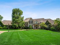 TIMELESS ELEGANCE ABOUND IN THIS CUSTOM, ESTATE-LIKE HOME